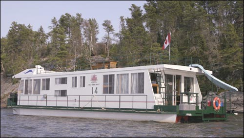 20' wide x 65' long Super wide body houseboat on lake of the woods